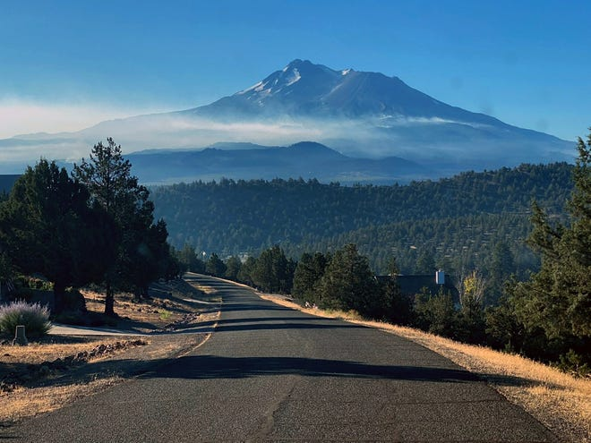 Smoke can be seen rising from the Lava Fire on Mt. Shasta's flanks from Rancho Hills on the morning of July 8, 2021.