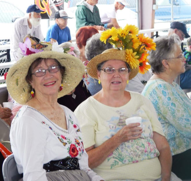 Women wear decorated hats to the Senior Day at the Anderson County Fair in 2019. The Best Decorated Hat is one of the competitions for the senior adults.