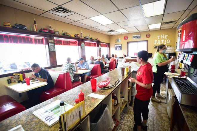 Customers eat inside at Patio Drive-In on Thursday, July 8 in Utica. The famous local diner announced via social media that they will be closing at the end of the month.