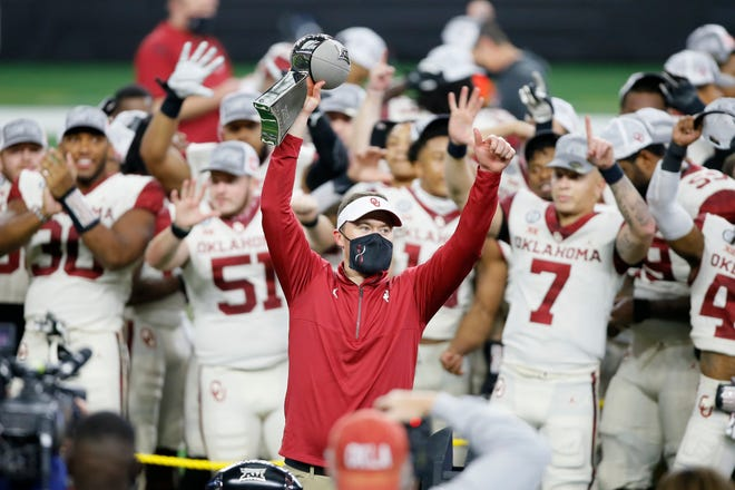 OU coach Lincoln Riley celebrates with the trophy after the Big 12 Championship victory in December over Iowa State. The Sooners were picked to win a seventh straight title in Thursday's preseason poll.
