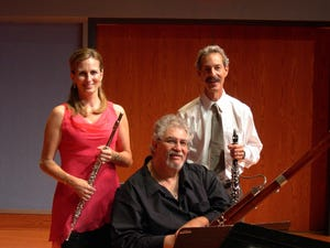 Founders of the Palm Beach Chamber Music Festival: Karen Fuller, flute, from left; Michael Ellert, bassoon; Michael Forte, clarinet.  The festival returns to in-person concerts this summer.
