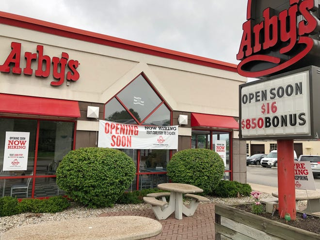Signs seen Thursday outside the Petoskey Arby's location on West Mitchell Street announce reopening plans as well as employment opportunities. Operators now aim to have the restaurant open again around mid-July.