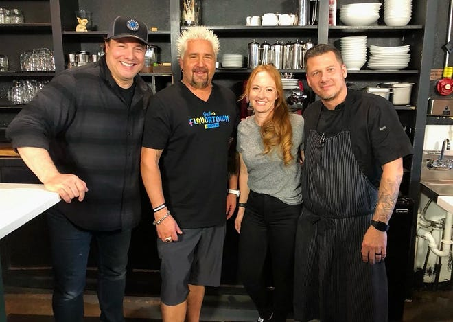 Food Network star Guy Fieri, second from left, poses for a photo with chef Tim Lipman, right, and Jenny Lipman, owners of Coolinary Café in Palm Beach Gardens. They are joined by star chef Rocco DiSpirito, left.