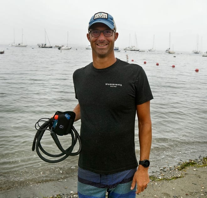 Jamestown ultra swimmer Ben Tuff holds the Ocean Guardian's Freedom 7 electronic shark repellent he will wear for his 19 mile, Block Island to Jamestown, swim on Sunday.