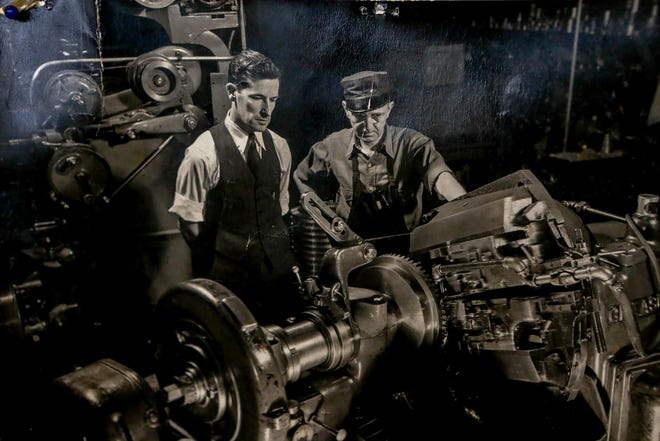 A photograph of Leo Tracey, left, hangs in the showroom of the Pawtucket company he founded in 1945, Tracey Gear & Precision Shaft.