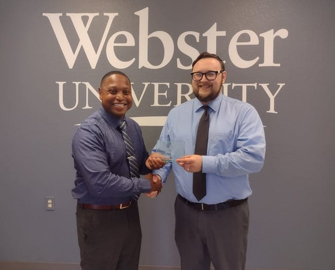 Allen Huerta was recently awarded Webster Rolla's Outstanding Graduate Student of the Year award. He is pictured here with the campus director, Dr. Greg Edwards.