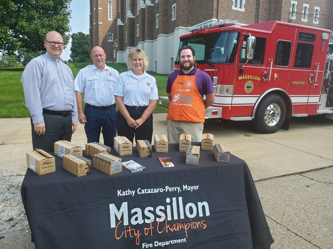 The Massillon Fire Department received a $2,500 donation from St. Paul Lutheran Church to purchase smoke alarms. The alarms will be distributed to city residents who do not have an alarm in their home. Pictured are St. Paul Lutheran Rev. Mark Kreemer, Fire Marshal Chuck Ganoe, fire inspector Tammy Wagner and Caleb Hunt, pro desk supervisor at Massillon's Home Depot.
