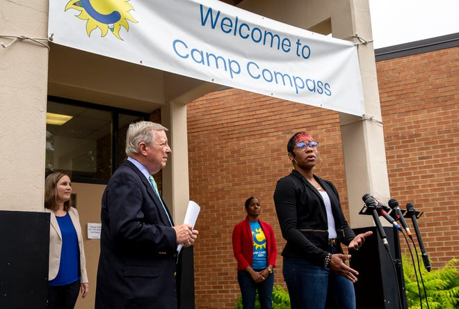 Myra Tyler, right speaks to how the Child Tax Credit will help benefit her family as she speaks during a press conference with U.S. Sen. Dick Durbin, D-Ill., at Jane Addams Elementary School in Springfield, Ill., Thursday, July 8, 2021. Sen. Durbin toured the Camp Compass program after discussing the expanded Child Tax Credit during a press conference at the school. [Justin L. Fowler/The State Journal-Register]