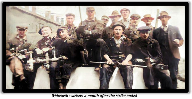 A group of Walworth workers pose for a photo following a 1920 strike.