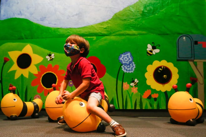 Reed Benaka bounces on a bee Thursday morning in the newest exhibit at the Kansas Children's Discovery Center.