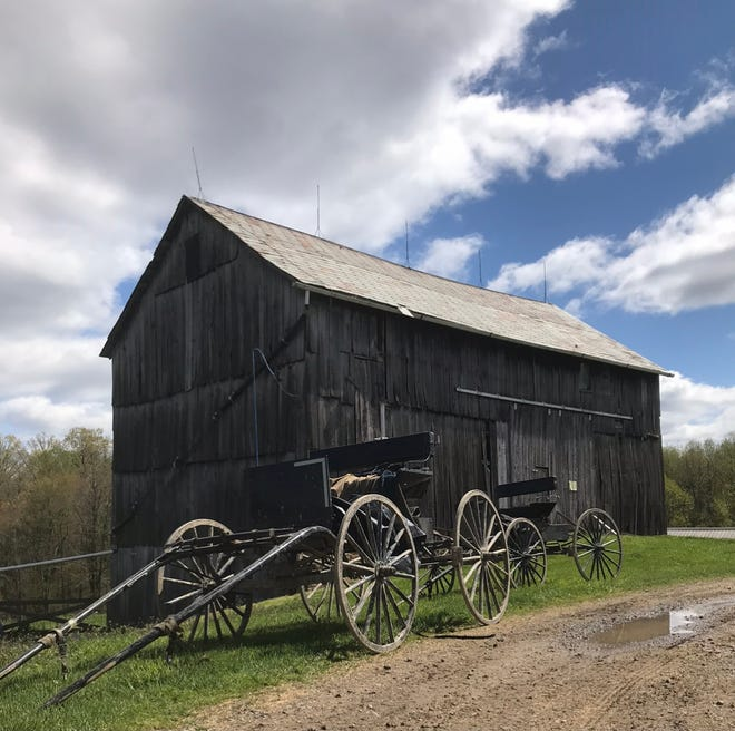 The nearly 100-year-old bank barn on the Steve and Renee Parker farm as it appeared before being replaced.