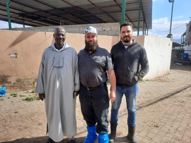 Joe Miller of Sugarcreek (center) is shown with two men in Morocco.