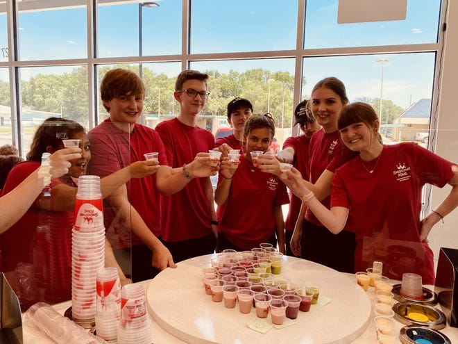 Smoothie King team taste testing smoothies located on Oil Hill road