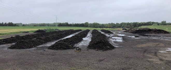 The composting of biosolids, leaves and wood chips by microorganisms occurs in windrows at the Appleton Biosolids Compost Facility. The process takes about 12 weeks.