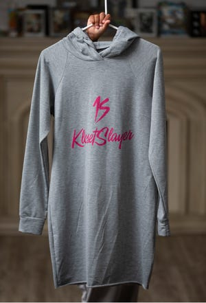 Marcia Ansparger Santiago owns Kloset Slayer, a designer clothing company that is gaining traction. The clothing line has been featured on magazine covers and shown on the runways of New York fashion week. Kloset Slayer loungewear hoodie dress.                                          Barnegat, NJThursday, July 8, 2021
