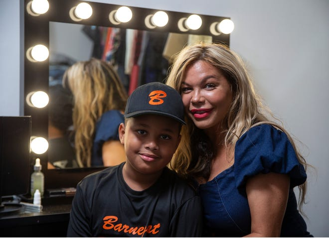 Marcia Ansparger Santiago owns Kloset Slayer, a designer clothing company that is gaining traction. The clothing line has been featured on magazine covers and shown on the runways of New York fashion week. Santiago with her son Baylon Jackson in her home design studio.                                         Barnegat, NJThursday, July 8, 2021