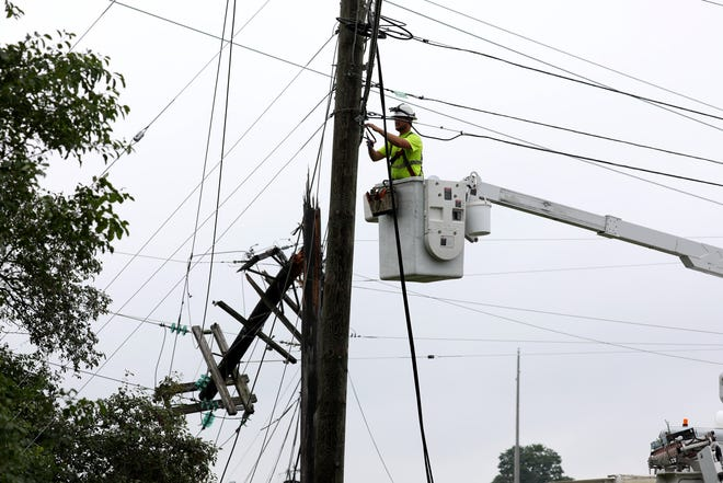 Repair crews were busy working on snapped power and cable lines around parts of Metro Detroit including here near Haggerty Road and Grand River Avenue in Farmington Hills on July 8, 2021. Severe storms left damage from fallen branches to power outages.
