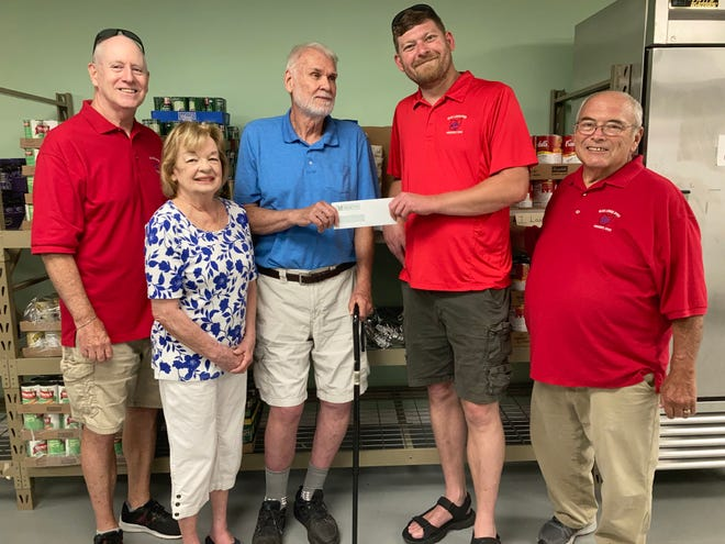 Elks Exalted Ruler Lee Celek, second from right, presents a check for $5,500 to Roy Wilhelm, president of the Sandusky County Food Pantry. Others in the picture include, from left, Elks Trustee Mike Kelly, the food pantry's Marty Wilhelm, and Elks Secretary Brad Lawrence.
