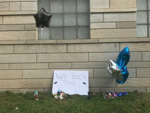 A small memorial in Terre Haute honors detective Greg Ferency, who was fatally shot July 7 at the FBI Indianapolis Resident Agency building.