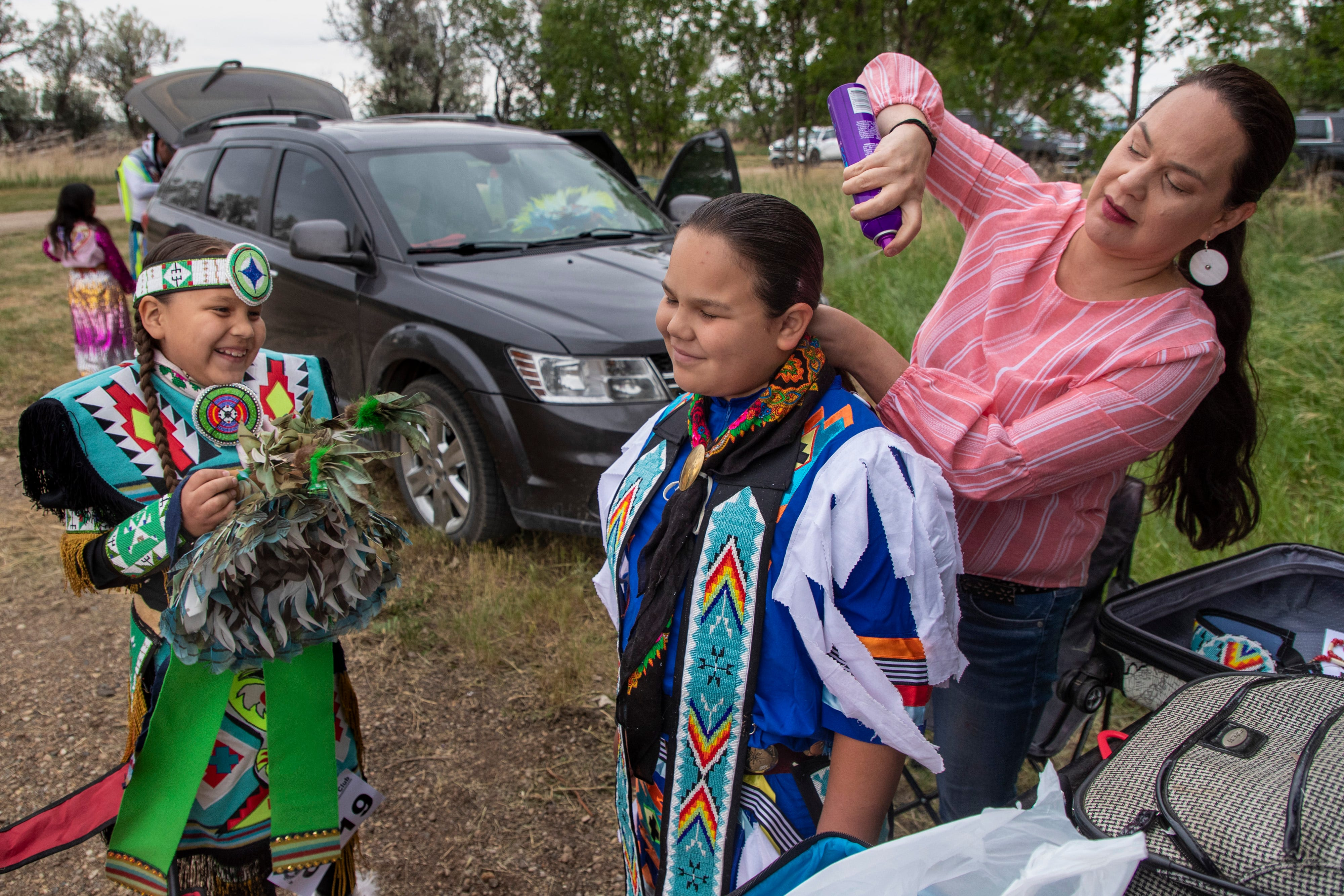 Children are readied for dancing at the Santee Lucky Mound Pow Wow in Parshall, North Dakota. June 25, 2021