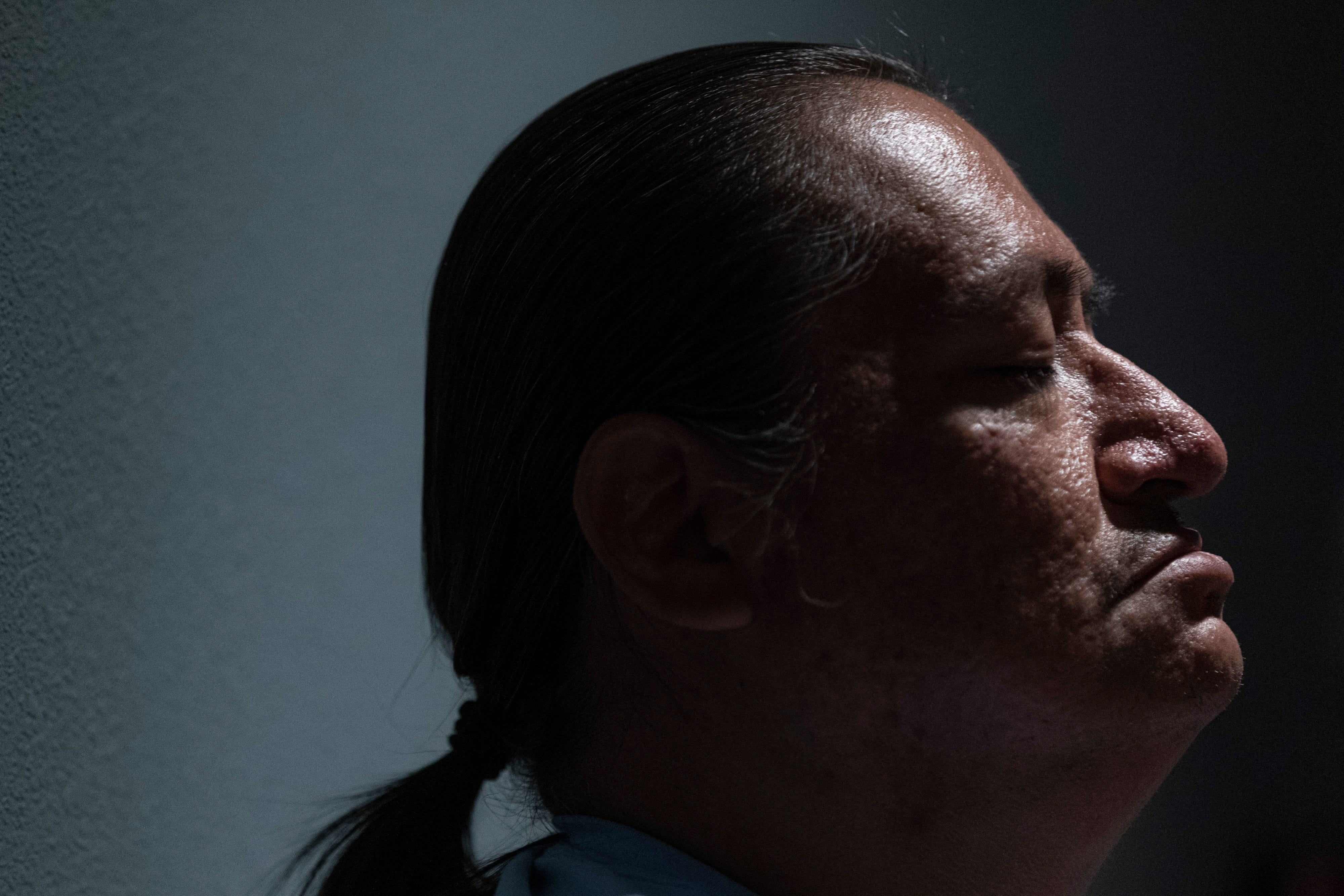 Kerry Hunts Along closes his eyes in meditation during the morning smudging at the Good Road Recovery Center in Bismarck, North Dakota. June 22, 2021