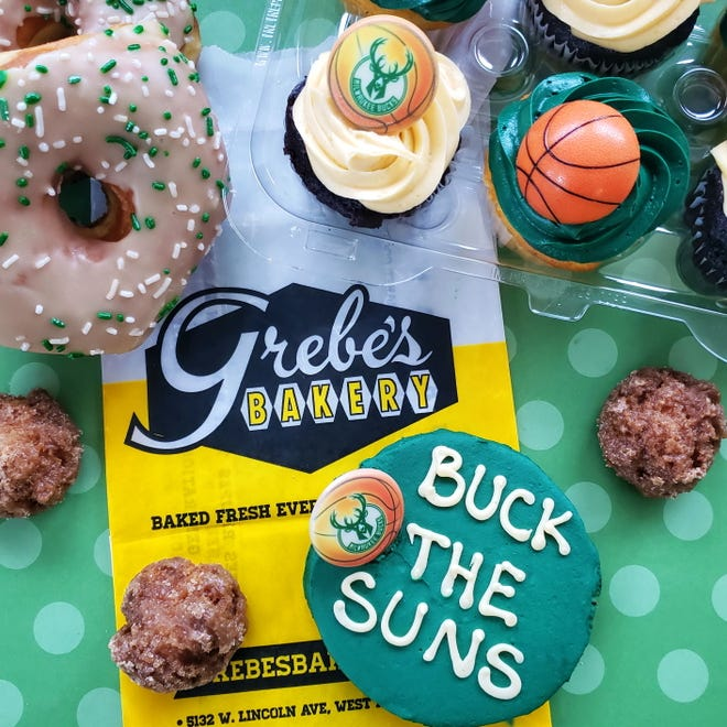 """Grebe's Bakery, 5132 W. Lincoln Ave., West Allis, is selling Milwaukee Bucks-themed cookies to coincide with the team's' quest for an NBA title. Shown are """"Buck the Suns"""" cookies, buttercream-iced Bucks cupcakes, maple-iced raised doughnuts and cruller nuggets."""