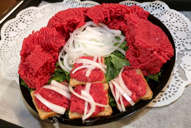 The cannibal sandwich, made from raw beef and onions on rye bread, at Ray's Butcher Shoppe in Greenfield. The sandwich is a popular menu item at family gatherings, weddings, anniversaries and more. Ray's Butcher Shoppe goes through around 1,000 pounds of ground round during the holidays.