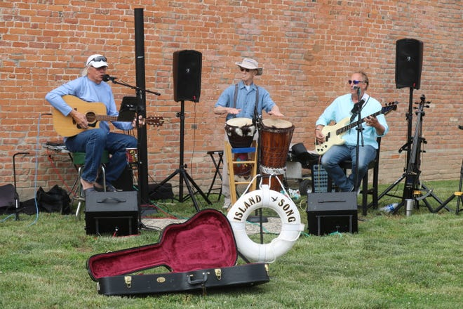 """John """"Crash"""" Davenport, left, and his band Island Song perform in downtown Port Clinton during a recent GPAAC Art Walk, which are held every other Thursday along Madison and Second streets."""