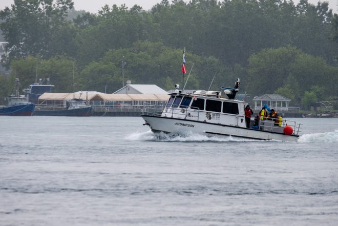 The St. Clair County Sheriff Dive Team searches the St. Clair River after a person was seen in the water Thursday morning, July 8, 2021, in Port Huron. The body of a 32-year-old Sarnia, Ontario man was found later that evening.