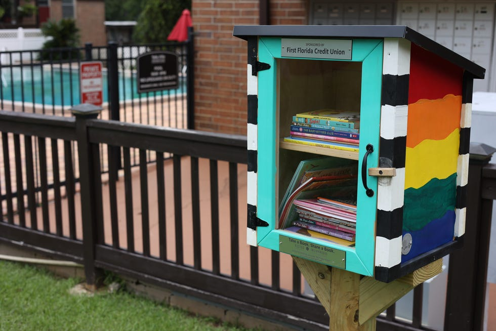 A little library sits in front of the mailboxes at Talla Villa Apartments on Thursday. The library with free books for children is a service project by Access Tallahassee.
