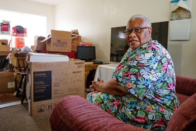 Dorothy Snell, 66, sits on the couch in her living room surround by boxes packed with her belongings as she prepares to move to a different rental property Thursday, July 8, 2021.
