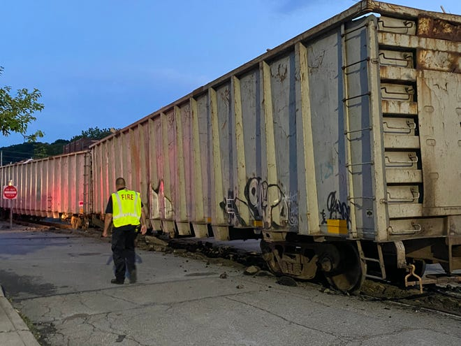 Chunks of concrete can be seen along the train track on Main Street where nine cars derailed Wednesday night.