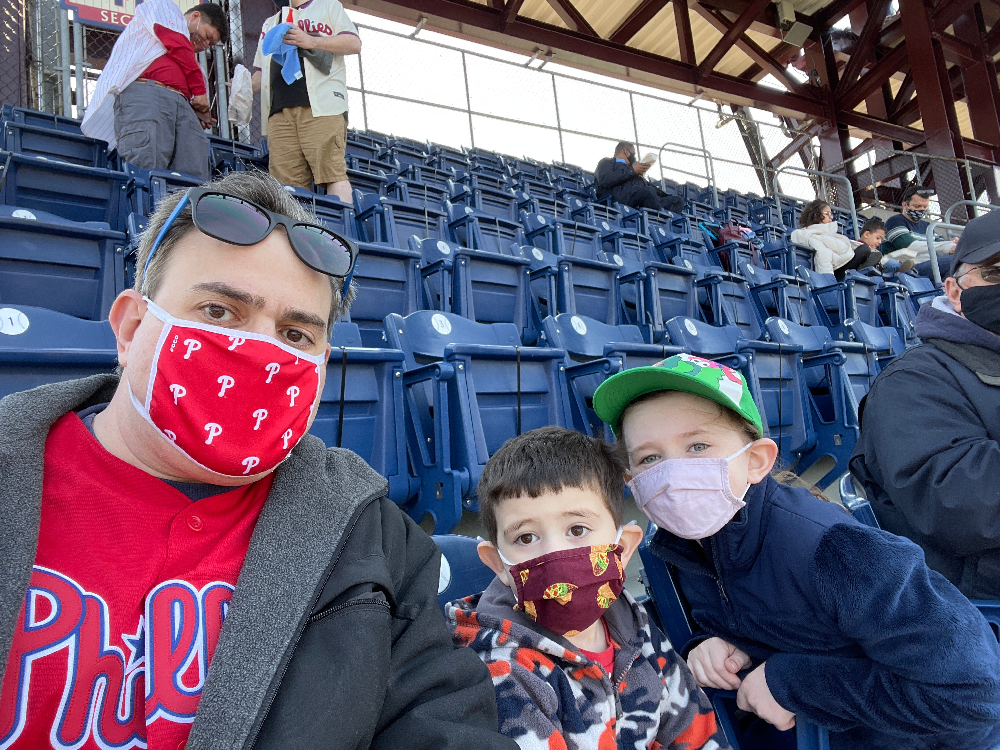 Daniel Horowitz, 42, takes his children, Adam, 4, and Emily, 8, to Citizens Bank Park in Philadelphia on April 4. Horowitz is concerned unvaccinated adults could endanger his son and daughter.