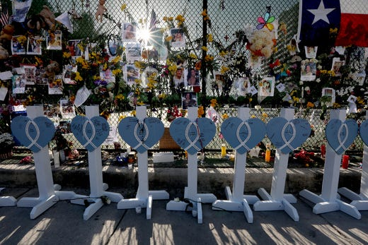 A collection of wooden hearts with the names of some of those who were lost in the Champlain Towers South condo collapse in Surfside Fla., photographed July 8, 2021.The hearts have been placed at the memorial wall dedicated to those lost.
