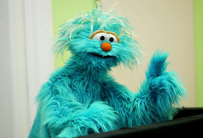 """Rosita, the Mexican-American Muppet of """"Sesame Street,"""" talks to kids about stress in the aftermath of the Sept. 11, 2001, terrorist attacks, as part of the """"You Can Ask!"""" program, June 25, 2003 in New York City."""