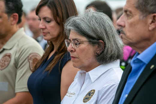 Miami-Dade County Mayor, Daniella Levine Cava, center, stands with other officials in from of the rubble that once was Champlain Towers South in Surfside, Fla., Wednesday, July 7, 2021.