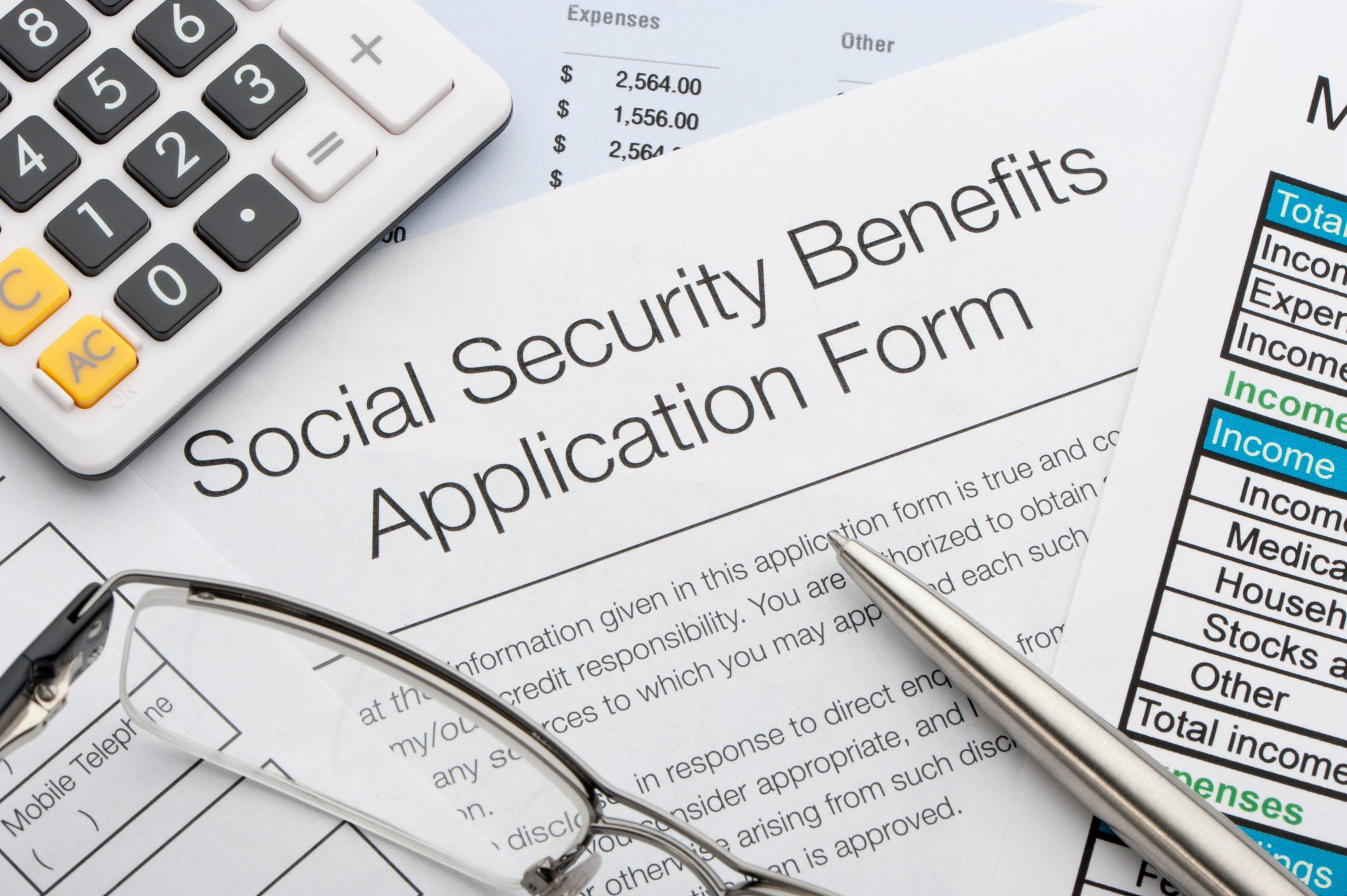 """An illustration shows a sheet that reads, """"Social Security Benefits Application Form."""""""