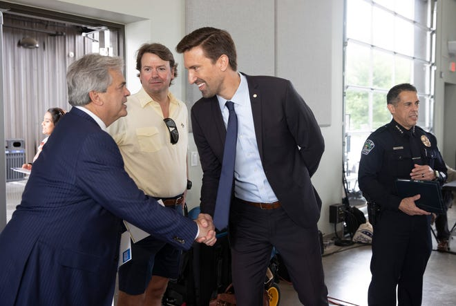 Austin City Manager Spencer Cronk, right, greets Mayor Steve Adler during a July 9 event to present Cronk's proposed budget for the coming fiscal year. The City Council is expected to approvea budget by the end of the week.
