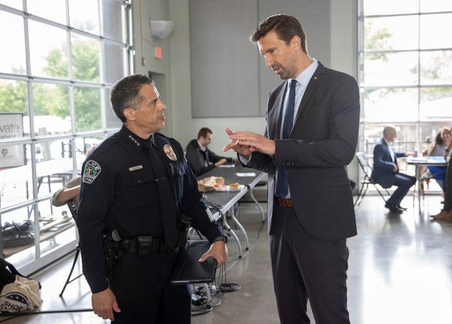 Austin City Manager Spencer Cronk talks with interim Police Chief Joe Chacon earlier this month.