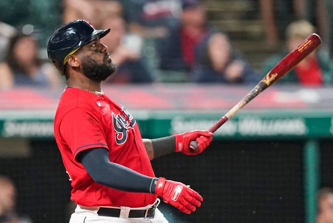 Cleveland's Franmil Reyes watches his three-run home run in the ninth inning of the team's win over Kansas City on Thursday.