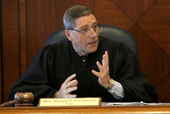 Judge Ronald P. Forsthoefel instructs the jury during the sentencing phase of the Shawn M. Grate trial Friday, May 18, 2018 in Ashland County Common Pleas Court. Tom E. Puskar, Times-Gazette.com