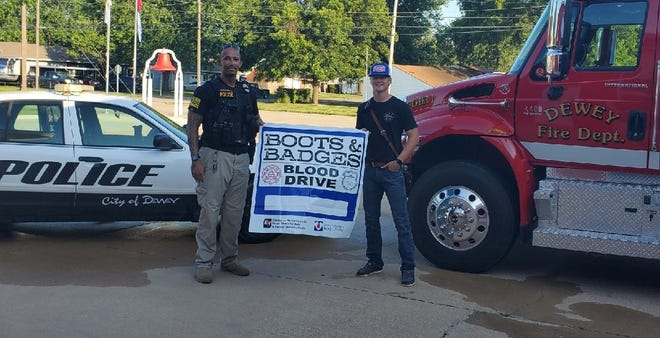 Dewey police officers and firefighters urge people to donate blood during the Boots & Badges Blood Drive.