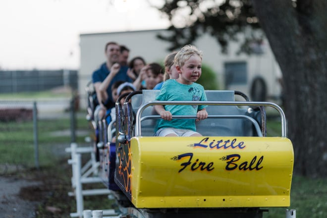 Logan Schmidt rides Little Fire Ball on Thursday night at Kiddie Park in Bartlesville.  The park at 205 S Cherokee Ave. is open from 7 to 9:30 p.m. Tuesday through Thursday, 7 to 10 p.m. Friday and Saturday, and closed Sunday and Monday.