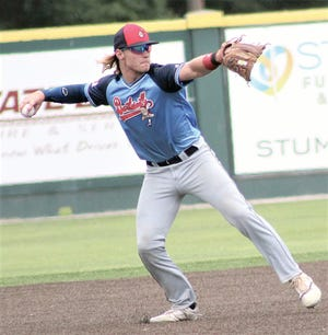Bartlesville Doenges Ford Indians' infielder Karson Lee prepares to gun the ball across the infield during Connie Mack regional play.