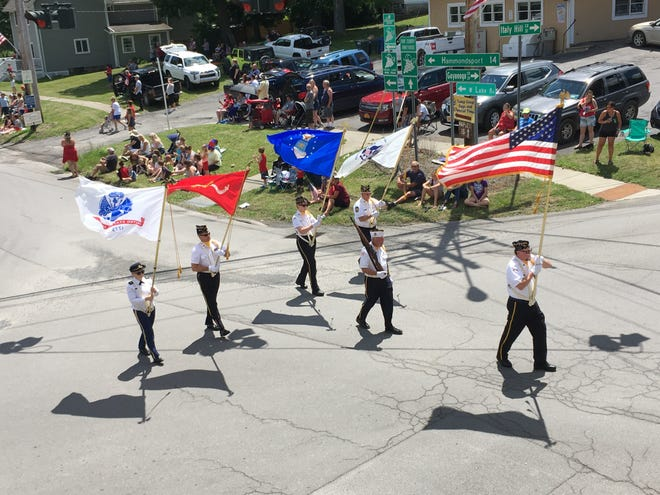 The Penn Yan American Legion color guard leading the July 4th parade in Branchport.
