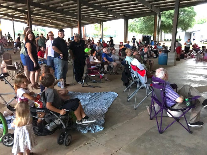 Families and neighbors socialize before the start of a previous Family Movie Night feature at the Twin Hills Park amphitheatre in Crestview.