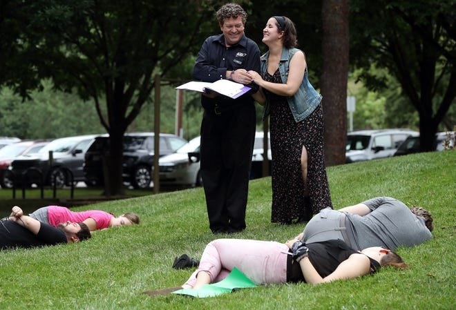 """Todd Decker of Columbus and Mollie Kalaycio of Dublin rehearse a scene for """"A Midsummer Night's Dream"""" with fellow Grandview Carriage Place Players actors June 29 at the McKinley Field park in Grandview Heights."""