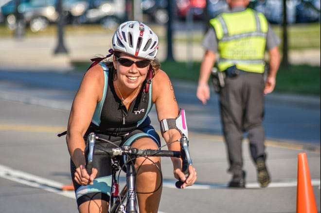 A participant in the 2019 Harvest Sunrise Triathlon in Delaware County navigates an intersection in the cycling portion of the event. The Delaware County Sheriff's office has indicated that it will not staff the event this year.