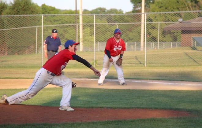 Cade Coauette fires a pitch as first baseman Brooks Butt gets in fielding position.