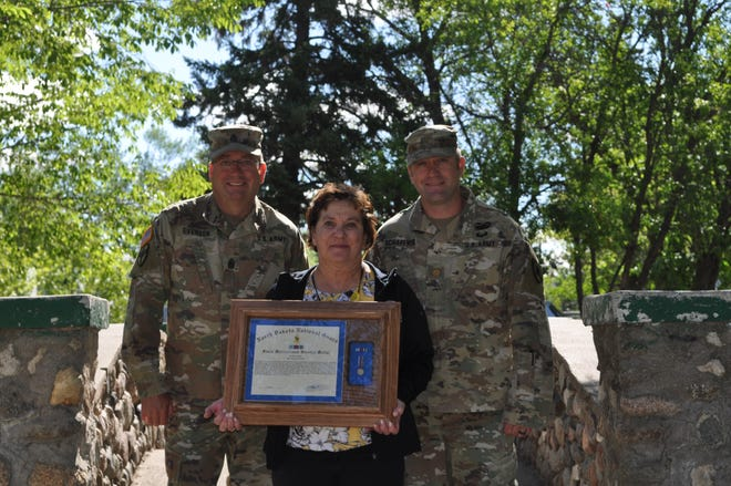 Major Chance Schaffner, OIC, and CSM Cory Everson, Commandant, both from the 164th Regiment Regional Training Institute had the pleasure of awarding civilian, Annette Groves, the North Dakota State Meritorious Service Medal.